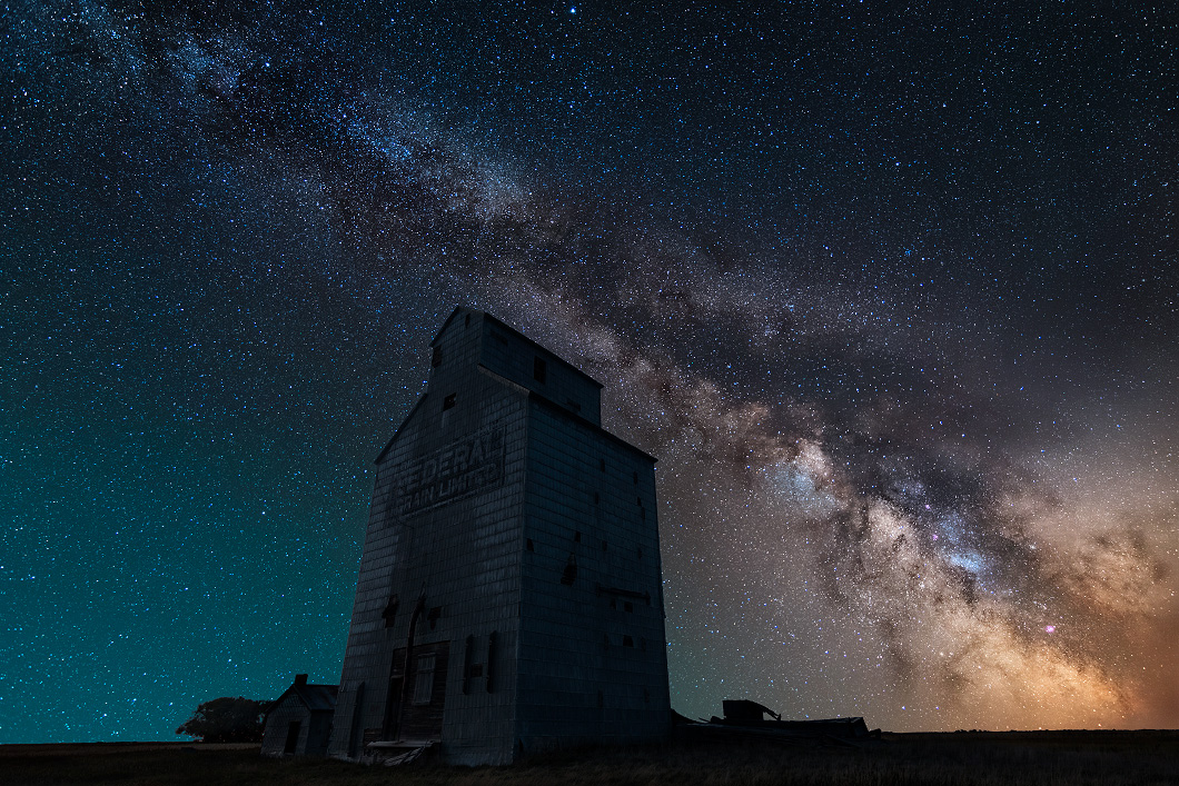 A fine art nature photograph of the milky way night sky over the prairies in Saskatchewan by Bryce Mironuck