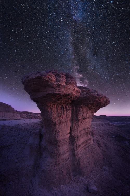 A fine art nature photograph taken of the night sky with the milky way in the badlands of Saskatchewan by Bryce Mironuck