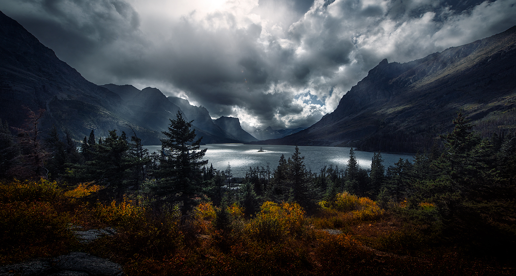 A fine art nature photograph of Saint Mary's Lake with light beams in the afternoon in Glacier National Park, Montana by Bryce Mironuck