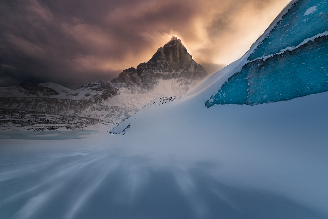 A fine art nature photograph taken at sunset at the columbia icefields along a frozen lake in winter in Alberta by Bryce Mironuck