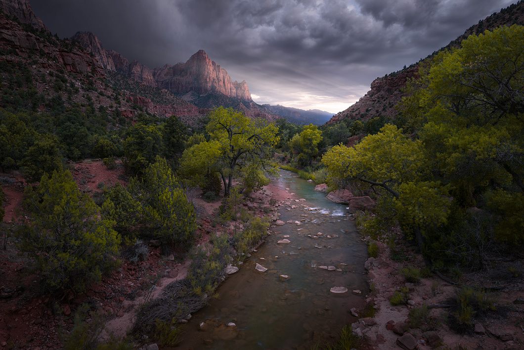A fine art nature photograph of the sunset in the mountains in Zion National Park, Utah. Taken at watchmen point by Bryce Mironuck