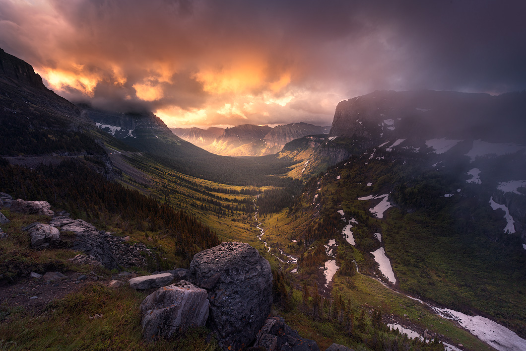 A fine art nature photograph of the sunrise in Glacier National Park, Montana, looking down into a valley between mountains by Bryce Mironuck