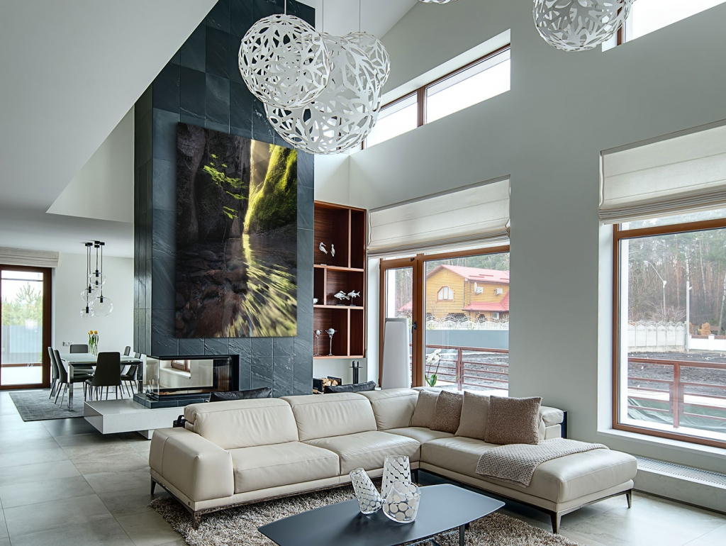 A photography print in a living room, above a fireplace, similar to Peter Lik, by Bryce Mironuck
