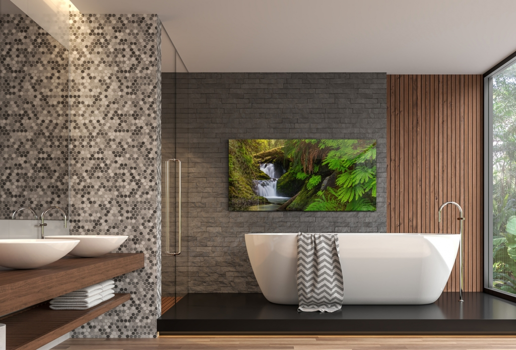 A photography print in a bathroom, above a bathtub, similar to Peter Lik, by Bryce Mironuck
